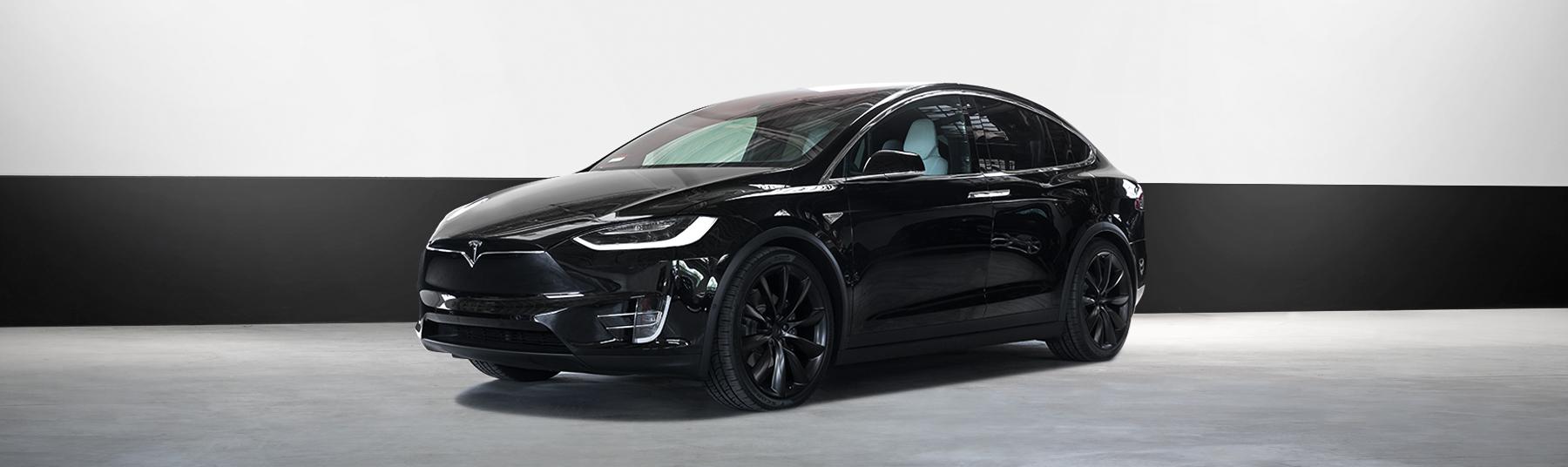 tesla electric car rental x1000d in black