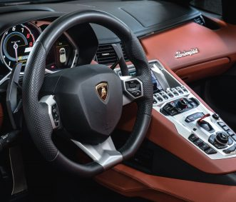 Grey Aventador Roadster Car Rental Steering