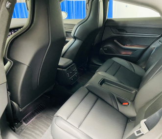 Porsche rental Taycan interior back row