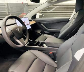 Tesla rental front seat