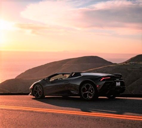 exotic car rental drive along with sunset